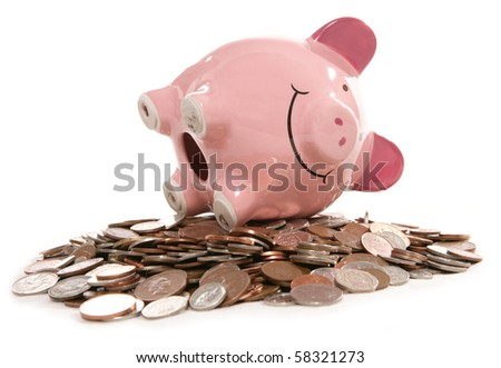 piggy bank moneybox with British currency coins - stock photo