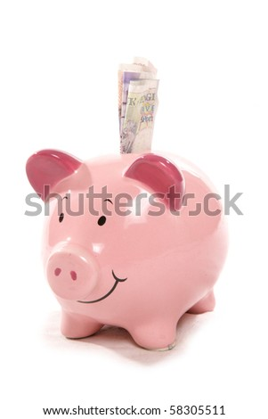 piggy bank moneybox with British currency money