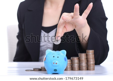 Piggy bank officer put money inside for invest in the future