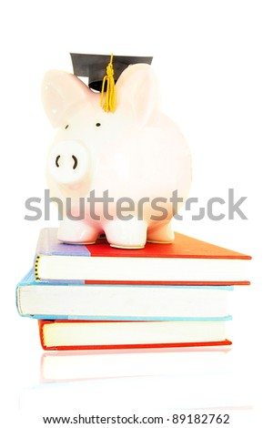 piggy bank on book pile - student debt concept - stock photo