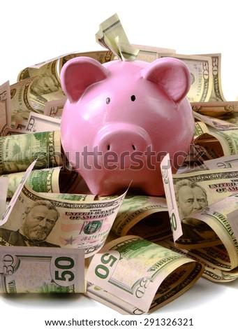 piggy bank on dollars, isolated on white background - stock photo