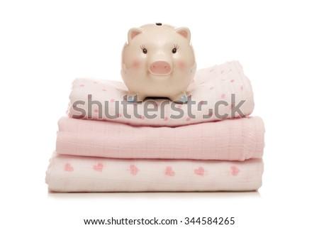 piggy bank on pink muslins cutout - stock photo