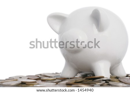 piggy bank on top of a pile of assorted world coins - stock photo