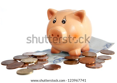 Piggy bank on twenty euro note and euro-cent coins isolated on white - stock photo