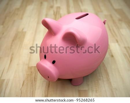 piggy bank on wooden floor - stock photo