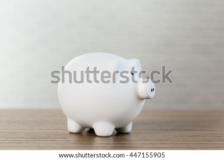 Piggy bank on wooden table