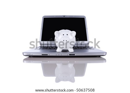 Piggy bank over a modern laptop, the cost of technology and information (isolated on white) - stock photo