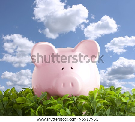 Piggy bank over blue sky - stock photo