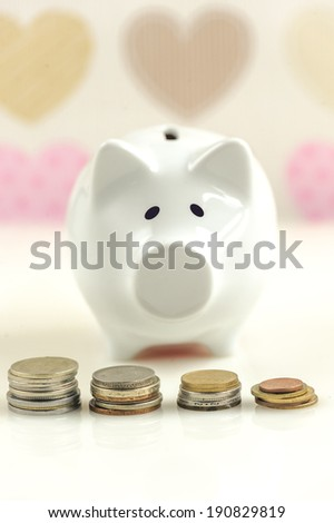 Piggy bank over heart cover wall paper