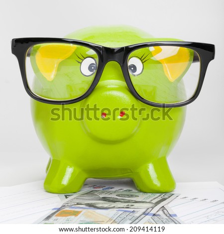 Piggy bank over stock market chart with 100 dollars banknote - 1 to 1 ratio - stock photo