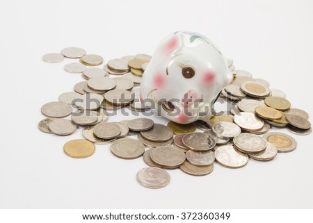 piggy bank Piggy isolated with a pile coins on the white background