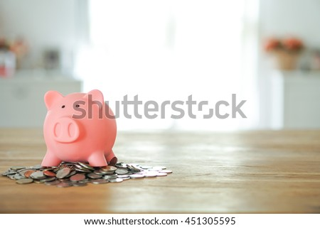 Piggy bank save coin on coin stack, time and money concept. copy space on right side. - stock photo