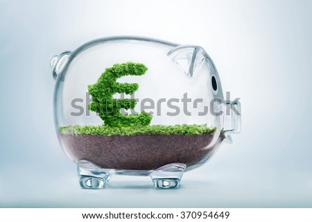 Piggy bank savings concept with grass growing in shape of Euro sign  - stock photo