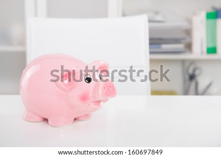 Piggy bank savings: Gone on holiday - background for money or saving concepts - stock photo