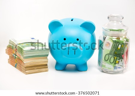 Piggy bank stack of euro banknotes bills and jar filled with money isolated on white background. Financial success idea. Way to save keep money concept. Private vs corporate capital  - stock photo