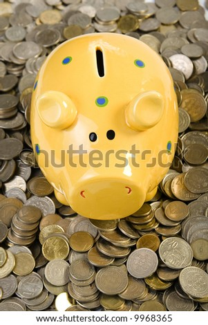 Piggy bank standing on coins. Business concept - stock photo