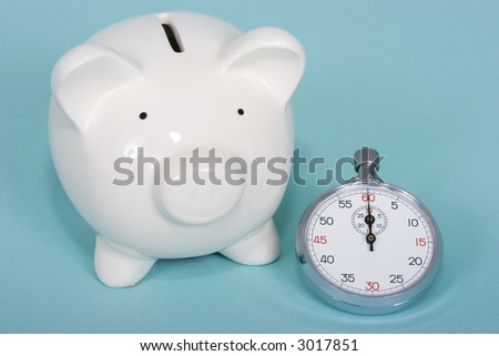 Piggy bank stop watch on blue background - stock photo