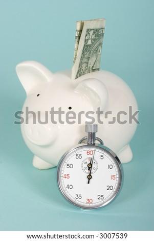 Piggy bank stop watch on dollar bill - stock photo