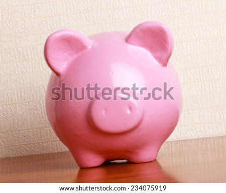 Piggy bank style money box - stock photo