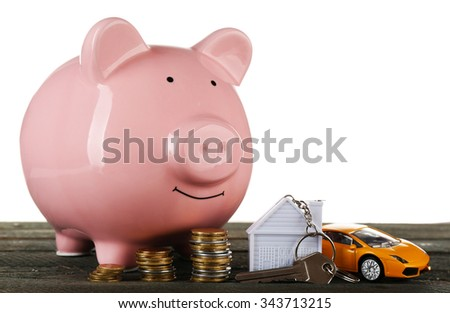 Piggy bank style money box on wooden table - stock photo