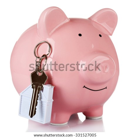 Piggy bank style money box with key isolated on a white - stock photo