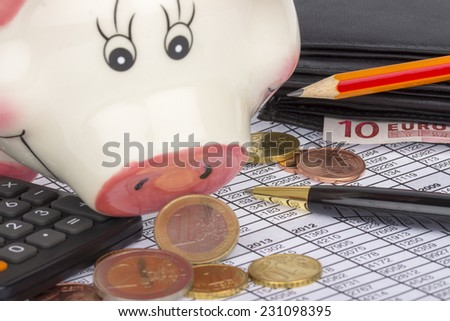 Piggy bank, wallet with euro banknotes and coins, calculator and pen on paper with financial situation - stock photo