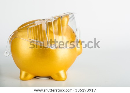 Piggy bank wear safety glasses  for protect your financial  with white background. - stock photo