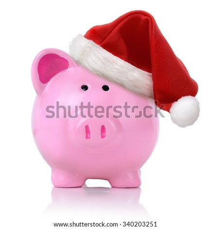 Piggy bank wearing a sant hat isolated - stock photo