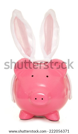 piggy bank wearing easter rabbit ears cutout