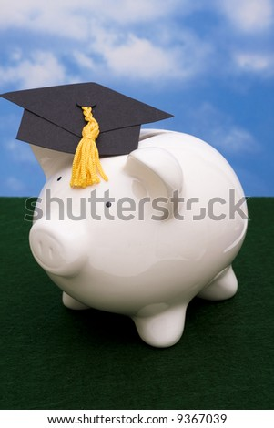 Piggy bank wearing graduation cap - stock photo