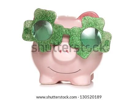 piggy bank wearing irish shamrock sun glasses studio cutout - stock photo