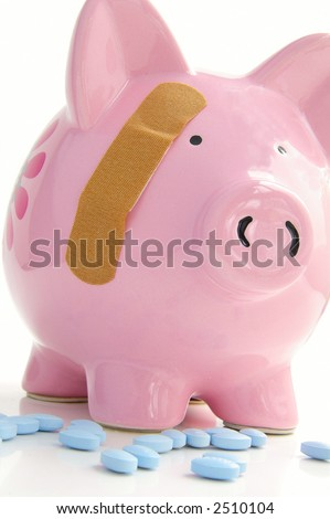 Piggy bank with a bandage and pills. Healthcare costs. - stock photo