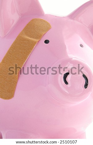 Piggy bank with a bandage closeup. Healthcare costs - stock photo