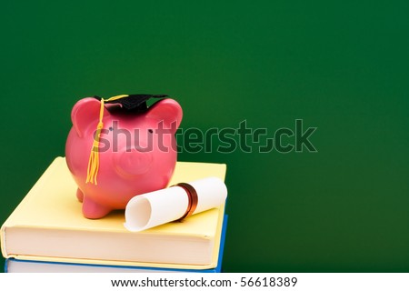 Piggy bank with a grad cap and diploma on a stack of books, Education scholarship - stock photo