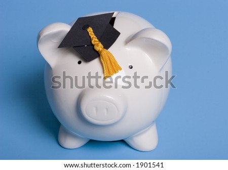 Piggy bank with a graduation cap - stock photo
