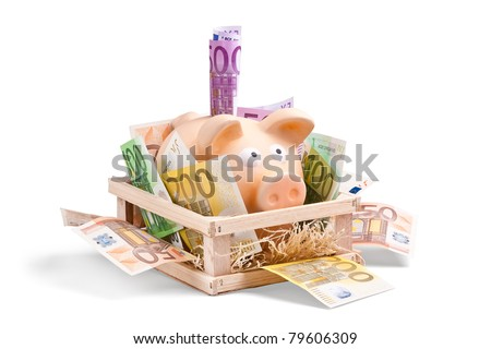 Piggy Bank with a lot of Euro Bank Notes surronding him in his house - stock photo
