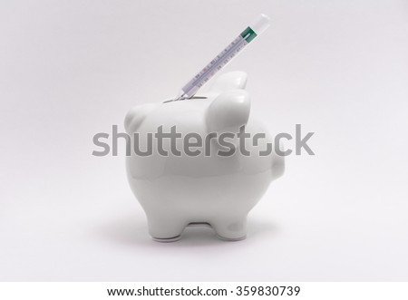Piggy bank with a thermometer to measure temperature