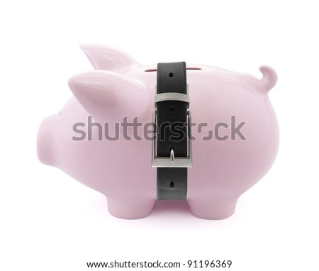 Piggy bank with a tight belt - stock photo