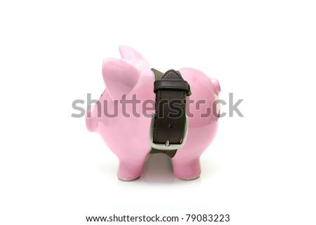 piggy bank with a tight belt -  saving money concept - stock photo