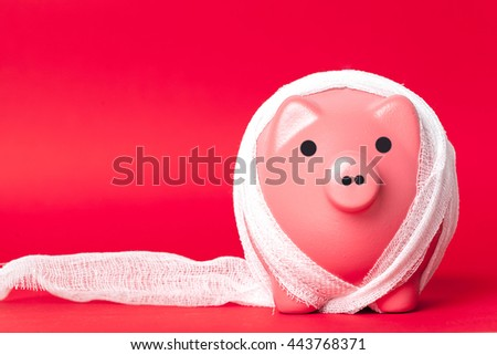 piggy bank with a white bandage