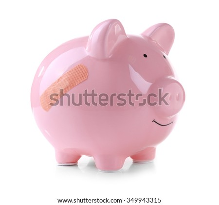 Piggy Bank with adhesive bandage, isolated on white
