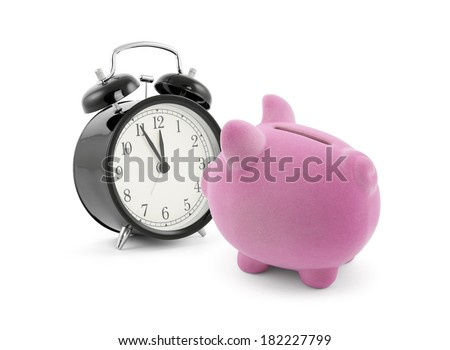 Piggy bank with alarm clock - stock photo