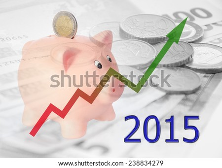 piggy bank with 2015 and euro background - stock photo