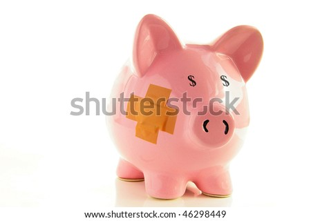 Piggy bank with bandage, metaphor for healthcare costs - stock photo