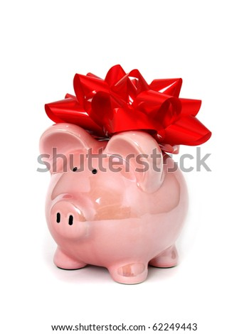 Piggy bank with big red bow - stock photo
