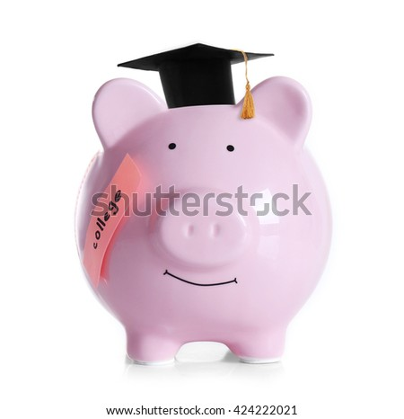 Piggy bank with black graduate hat isolated on white. Money for college concept