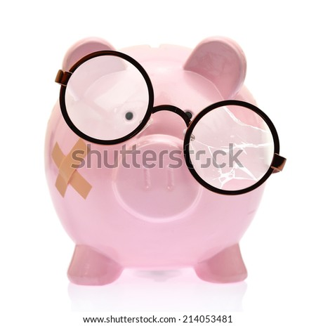 Piggy bank with broken eyeglasses and bandage - stock photo