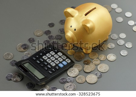 piggy bank with calculator. financial concept - stock photo