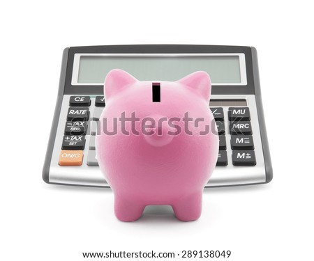 Piggy bank with callculator isolated on white - stock photo