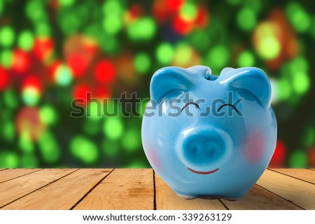 piggy bank with Christmas decoration background, abstract background to time to start to saving or solution for keep money for celebration. - stock photo